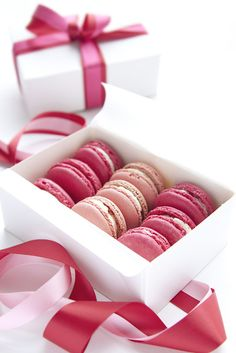 Pink macarons in white package with pink ribbons