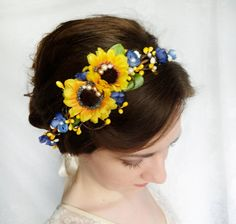 Gorgeous rustic-style headpiece featuring an assortment of sunflowers, wildflowers, twigs and foliage. Note: blue flowers may be slightly different than shown, but same color/size. I adore this for engagement shoots or a country wedding/festival! Adds a cheerful pop of color to your outfit. -- Colors: yellow, green, royal blue -- Materials: faux silk flowers, pip berry vines, pearls -- Tie with ribbons in the back, or wear as a headband -- High quality silk-like blooms Due to the...