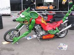 """This bike was created by Ed """"Big Daddy"""" Roth to model his character Rat Fink. (His Mickey Mouse antihero.) Big Daddy Roth was one of America's greatest motorhead counter culture figures of the Triumph Motorcycles, Cool Motorcycles, Harley Davidson Motorcycles, Rat Rod Motorcycle, Motorcycle Design, Rat Fink, Custom Bikes, Custom Cars, Custom Choppers"""