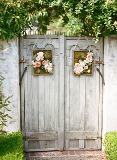 old doors as garden gates ~ Love the touch of flowers, feel welcome and at home