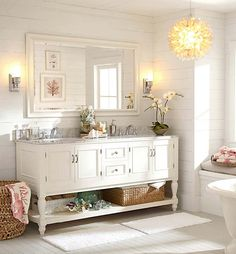 We love a bath that feels light and airy. #potterybarn