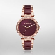 Parker Rose Gold-Tone and Plum Acetate Three-Hand Watch The Michael Kors Parker watch exudes glamour. Polished rose gold-tone and faceted plum acetate center links alternate on the bracelet, and the plum mother-of-pearl dial is finished with a pavé crystal topring.