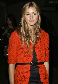 Olivia Palermo at Mercedes-Benz Fashion Week  oranje kant/broderie blazer/vest