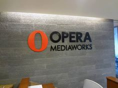 Custom painted acrylic letters and logo mounted with adhesive onto stone interior wall in NYC. For more information on office signs, visit http://www.SignsVisual.com