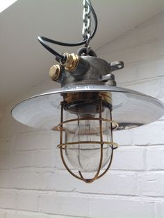 Cast Iron and glass. Sold without chain and s-hook. This excellent example of an original explosion proof lamp which was salvaged from an old Japanese cargo ship.