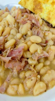 Slow Cooker Ham & White Beans – the best way to use up your holiday ham! Serve w… Slow Cooker Ham & White Beans – the best way to use up your holiday ham! Serve with cornbread for a full meal! Lima Beans And Ham, White Beans And Ham, Ham And Bean Soup, White Bean Soup, Navy Bean Soup, Lima Bean Soup, Green Beans, Bean Soup Recipes, Crockpot Recipes