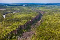 The Ouimet Canyon, located in the Ouimet Canyon Provincial Park is 100 metres deep, 150 metres wide about two kilometers long and plays host to a variety of rare arctic dwelling plants. Ontario, Travel Guides, Travel Tips, Travel English, Lake Mountain, Nature Reserve, Aerial View, Canada, Places To Go
