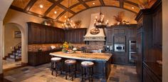 The ceiling in this country elegant kitchen is a work of art. Also, love the brick backsplash. #EyeCatchingKitchens #JJCH