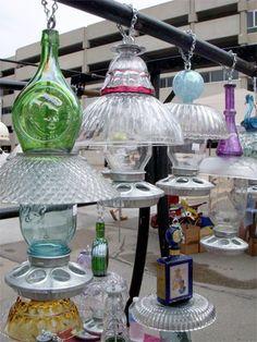 Bird feeders of old glassware, mason jars and chicken feeder