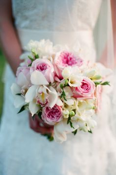 #bouquet, #orchid, #rose  Photography: Marta Locklear - martalocklear.com  Read More: http://www.stylemepretty.com/2014/05/09/outdoor-southern-orchard-wedding/