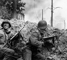 The Battle of Stalingrad was one of the biggest battles of World War II. During the battle, both the Soviets and the Germans suffered significant losses. Battle Of Iwo Jima, Battle Of Stalingrad, German Soldiers Ww2, German Army, Bataille De Stalingrad, Germany Ww2, German Uniforms, War Photography, Color Of Life