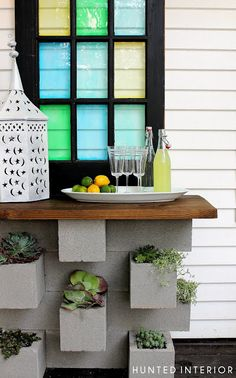 So stinking smart... cinder block planter and  a piece of stained wood on top for a cool outdoor buffet table.  Now I am wondering if I should paint the blocks... hmmmmm...