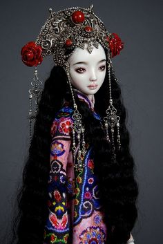 Sayan  - One of the extremely limited edition called Echo. There are only 5 dolls in the edition.All are dressed alike except for their head dress.