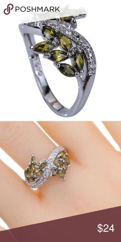 18k White Gold Plated CZ & Green Peridot Ring Beautiful, classy, and unique olive branch designed band. 18k white gold plated. AAA CZ and green peridot stones adorn this lovely ring. Approx 3mm in size. Tons of sparkle under the light! Brand new! ❤️ Boutique Jewelry Rings