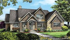 The Giselle, Plan 1295 This family-friendly plan features abundant windows both front and back, and a two-story vaulted ceili