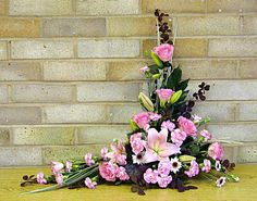 """Asymmetrical floral arrangement is a uneven shape, often """"L"""" or crescent, with a gentle curve. The flowers are usually arranged so the one side of the bouquet is tall and thin while the other side. Altar Flowers, Church Flower Arrangements, Home Flowers, Church Flowers, Beautiful Flower Arrangements, Funeral Flowers, Bunch Of Flowers, Simple Flowers, Different Flowers"""