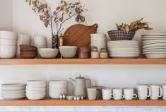 Heath ceramics on an open shelf