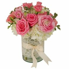 Dainty Lace - Pretty pink ranunculus and roses with cream hydrangea. The glass cylinder vase is wrapped with lace and tied with a satin ribbon. Pink Carnations, Pink Roses, Ranunculus, Glass Cylinder Vases, Recycled Glass, Hydrangea, Pretty In Pink, Floral Arrangements, Wedding Flowers