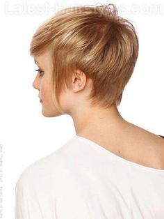 Short Hair.. strawberry-blonde pixie with longer sides. side-back view