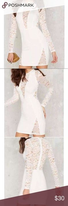 Nasty Gal lace dress White lace cut out dress in excellent shape, worn once and dry cleaned. Runs small fitting like a 2 or XS. Rayon, nylon, spandex blend, unlined. No trades. Nasty Gal Dresses Mini