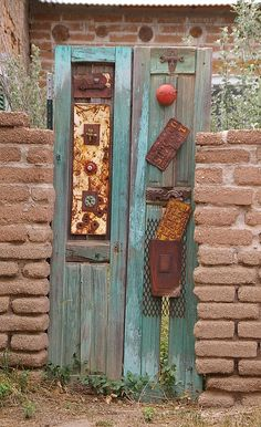 The New Mexican homeowners used a salvage door to create a mixed media art piece that they used as their garden gate.  Quirky and eye catching!  mix media art.  garden doors.  garden gate.  New Mexico. unique doors.
