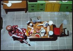 New Kitchen/Aerial View/Seated Artist: Laurie Simmons (American, born 1949) Date: 1979 Medium: Silver dye bleach print Dimensions: Image: 7.6 x 12.7 cm (3 x 5 in.)