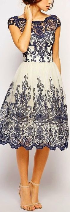 Adorable ladies white dress with navy blue lace