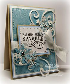 Season's Greetings set from My Favorite Things. I paired it with some SUPER shimmery paper from Heidi Grace,cardstock colors are Fossil, Sweet Tooth, and Spring Rain(PTI) cardstock. I used the Large Fancy Flourish Die-namics, and Let it Snowflake Die-namics with more of the Heidi Grace paper. Michael's brads were used in the center of my Snowflakes, and I used Sweet Tooth Grosgrain, as well. To make it just a little more sparkly, I went over the words in my sentiment with my Sakura Glitter…