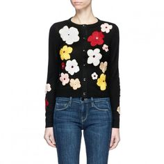 --evaChic--This Alice + Olivia Lyndia Floral Embroidered Cardigan from Resort 2017 features thickly embroidered springtime blooms on a classic style to be layered over silk tops and cotton shirts. It's a cheery motif of great textural value. Crafted from cotton blend, it works with all your transitional weather separates.      http://www.evachic.com/product/alice-olivia-lyndia-floral-embroidered-cardigan/