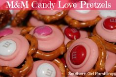 M Candy Love Pretzels: 1 bag of Valentines M, 1 bag of Candy Melts, 1 bag of Mini Pretzels. Preheat your oven on the broil setting. Place a layer of the pretzels on a baking sheet. Only add 8-10 at once. Top each pretzel with one candy melt. Place the baking sheet in the oven for 20-30 seconds, or until candy melts are slightly melted. Place one M in the center of each candy melt, pressing gently to spread the melted candy further onto the pretzel. Allow candy to cool/harden