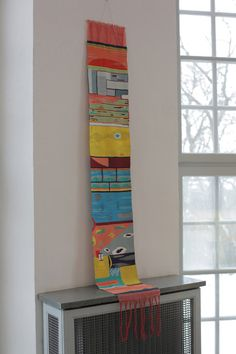 Do this with scrap yarn and thread twine at the top for hanging. This will offer color and warmth to walls and random dead space in a room :)