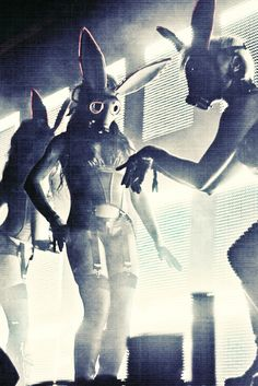 Futuristic Table Dancers in Playboy Gas Masks, black and white photo.