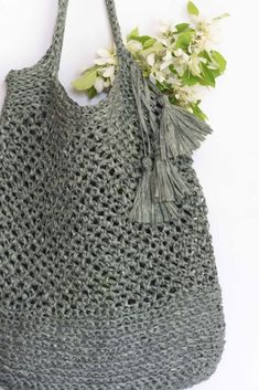 I've just finished crocheting this brand new market tote for spring! If you've crocheted a market tote, you probably remember that they're generally pretty easy to make and work up really quickly too. These are great to use for just about anything, including a trip to the swimming pool or the farmers market. You'll find the 'How To' below for this bag as well as a picture tutorial so you can make one for yourself. ;) A girl can never have enough bags (lol) and this &...