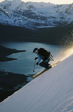 "Skiing above Sorfjorden in Lyngen Alps, Norway. Norwegians are the worlds first skiers. In the 1940s there was one place to ski. In Idaho ""Sun Valley"". I believe it was built for a Sonja Henie Movie in the 1930s, early 40s. Few people tried the slopes. It caught on through movies etc. Sonja Henie - famous Norsk movie star. Winter sports, Skating primarily."