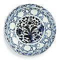 A rare and important blue and white barbed 'banana plant and peony' charger, yuan dynasty (1271–1368)