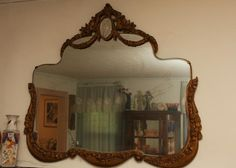 "Art Deco ornately shaped beveled glass wall mirror having gesso over wood over ornate frame and etched medallion at top, 39.5""x32""T. West Milford, NJ Auction ending 6/17/13."