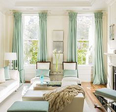 hanging draperies - Pale green stationary panels with woven tops hanging on a pair of windows - Leslie Fine Interiors via Atticmag
