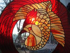 Stained glass Phoenix Bird Greek Mythology of long-lived, reborn, renew, regenerated, excellence and beauty. Shades of reds/orange and clear. $474.99, via Etsy.
