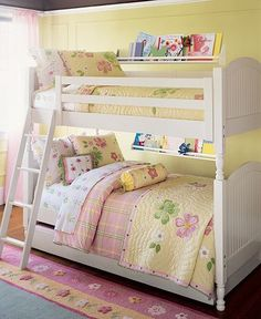 love the idea of having a mini bookshelf by beds