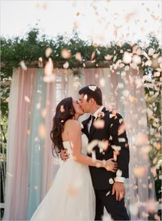 throwing the petals while the bride and groom are still at the altar sharing their first kiss… love this idea, sure makes for an excellent wedding photo!