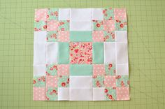Welcome! My name is Erica and I blog over at Kitchen Table Quilting. I absolutely loved working with Scrumptious; just sewing with it made me feel happy. This quilt is kind of a modified Irish C...
