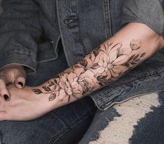 Forearm flowers tattoo