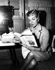 Lana Turner engrossed in her reading
