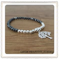A beautiful sterling silver bracelet with a tree charm.