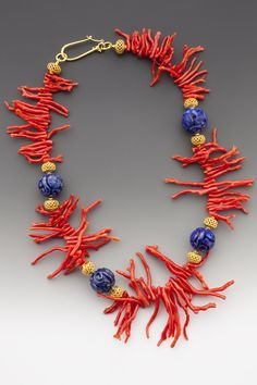 Delicate deep red graduated coral frangia is paired with carved deep blue Afghan. - Delicate deep red graduated coral frangia is paired with carved deep blue Afghani lapis lazuli beads - Coral Jewelry, Jewelry Art, Beaded Jewelry, Handmade Jewelry, Beaded Necklace, Jewelry Design, Statement Jewelry, Jewellery, Turquesa E Coral