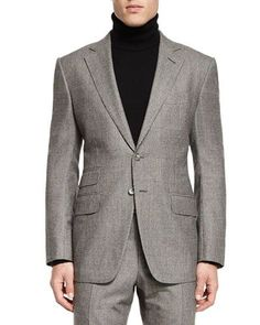 """Tom Ford """"O'Connor"""" base trim suit in large windowpane check. Narrow notch lapel; hand-finished double-stitched silk button hole. Two-button front with horn buttons. Front flap pockets, ticket pocket"""