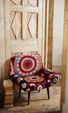 Take an old chair and reupholster with dramatic fabric for a pop of color.  In His Grip