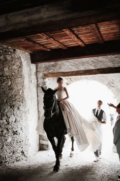 "The ceremony took place in a tiny chapel on the grounds. ""It was the perfect intimate setting for our 20 guests,"" says bride Wanwan Lei. ""In a reversal of the tale of Prince Charming riding a white horse, I rode up to the chapel at the castle to meet Lin Han."""