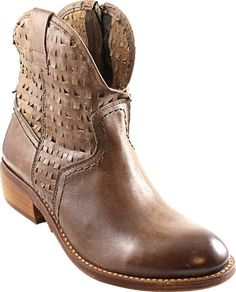 "Loving the ""holey"" details on this brand new Taos boot. #falltrends"
