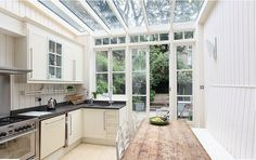 Love the idea of a kitchen with a glass ceiling!